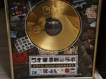 Золотые диски в рамках